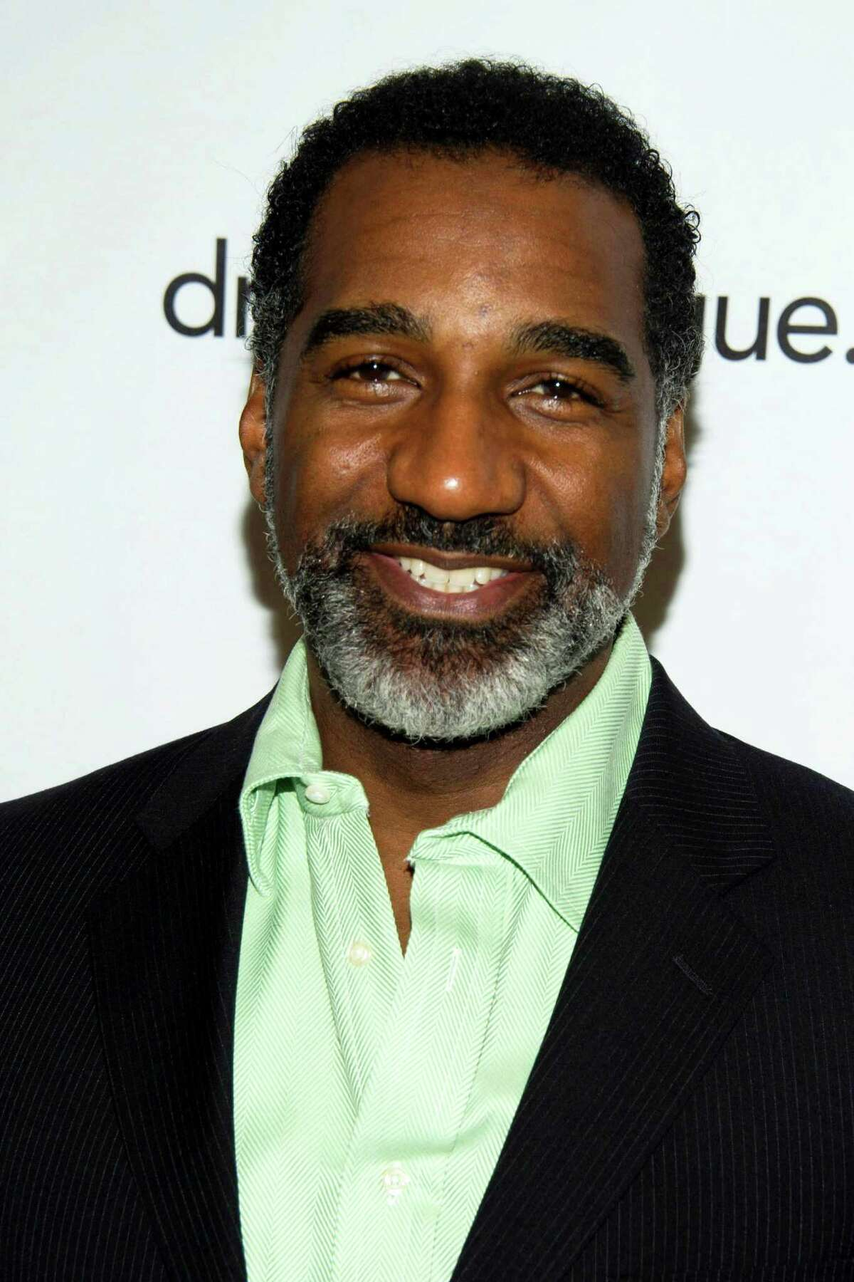 """FILE - This May 18, 2012 file photo shows actor Norm Lewis at the 78th Annual Drama League Awards in New York. Lewis has been tapped to be Broadway?s next Phantom in the megahit """"The Phantom of the Opera,"""" a move that makes him the first African American to slip behind the famous mask. (AP Photo/Charles Sykes, File)"""