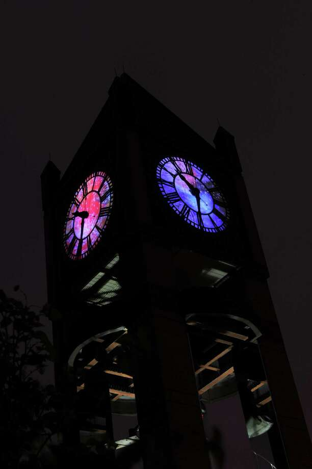 """Jo Ann Fleischhauer's """"What Time Is It?"""" is an art installation that transforms the Market Square clock tower. Photo: Jimmy Hemphill"""