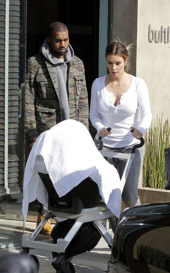 Kim Kardashian and Kanye West are seen with their daughter, North West, at Baulthaup kitchen store in West Hollywood on January 23, 2014 in Los Angeles, California. Photo: Bauer-Griffin, GC Images
