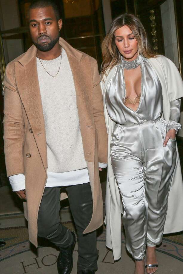 Kanye West and Kim Kardashian leave the 'Meurice' hotel on January 21, 2014 in Paris, France. Photo: Marc Piasecki, FilmMagic