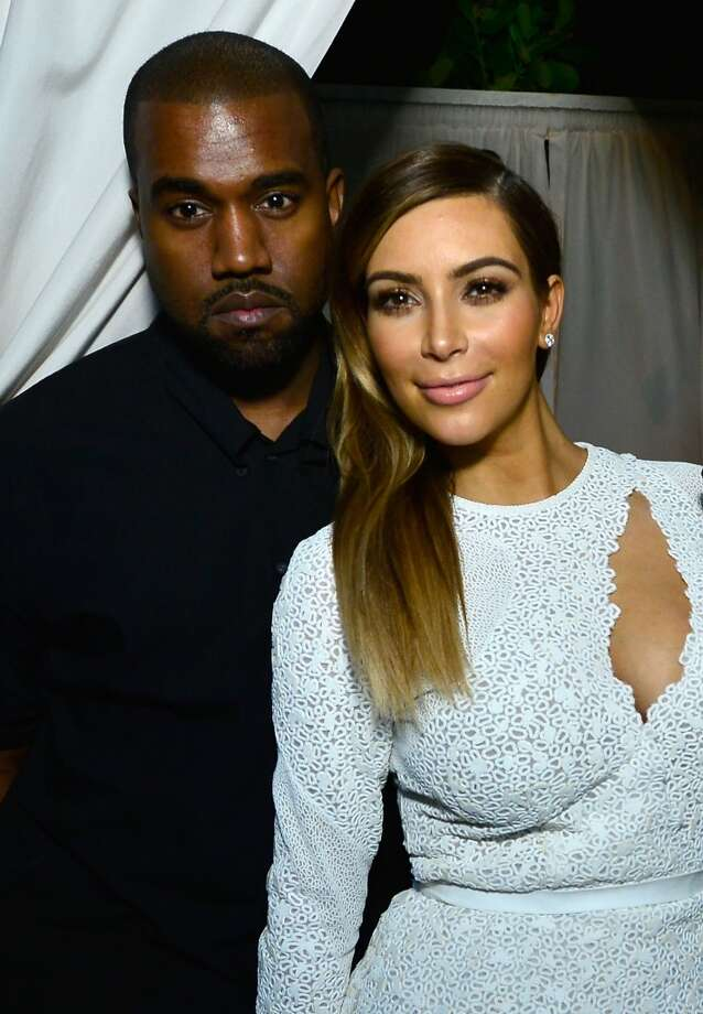 Kanye West and Kim Kardashian attend DuJour Magazine's event to honor artist Marc Quinn at Delano Beach Club on December 4, 2013 in Miami Beach, Florida. Photo: Eugene Gologursky, Getty Images For DuJour Magazine