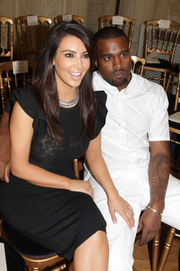 Kim Kardashian and Kanye West attend the Valentino Haute-Couture Show as part of Paris Fashion Week Fall / Winter 2013 at Hotel Salomon de Rothschild on July 4, 2012 in Paris, France. Photo: Michel Dufour, WireImage
