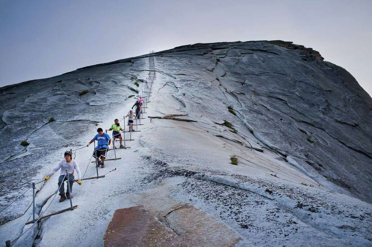 Participants in the Woods Project hike down Half Dome in Yosemite National Park in Northern California.