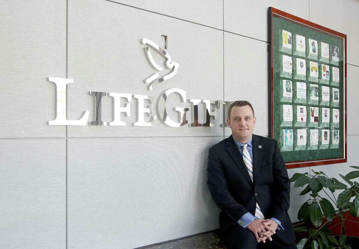 """2/27/14: Robert Boudwin is a Houston Hero """"Clutch"""" the Houston Rockets mascot but also does philanthropic work for other non-profit organizations. Here he poses in the Life Gift,building in Houston, Texas. His dad was a recipient of Life Gift."""