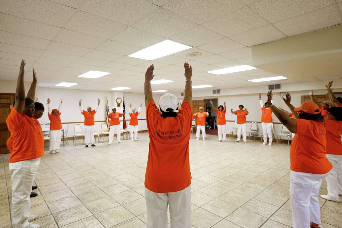 Eronia Taggy Hall, white hat, leads a group of seniors in an aerobics class, Thursday, February 27, 2014 in Galena Park Manor in Houston, Texas. Â TODD SPOTH, 2014