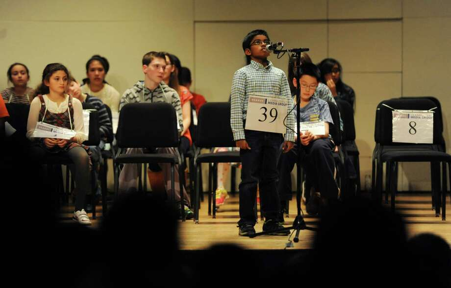 Aahil Nishad, of Danbury, spells a word at the Hearst Media Services Regional Spelling Bee at Western Connecticut State University in Danbury, Conn. Thursday, March 20, 2014. Photo: Tyler Sizemore / The News-Times