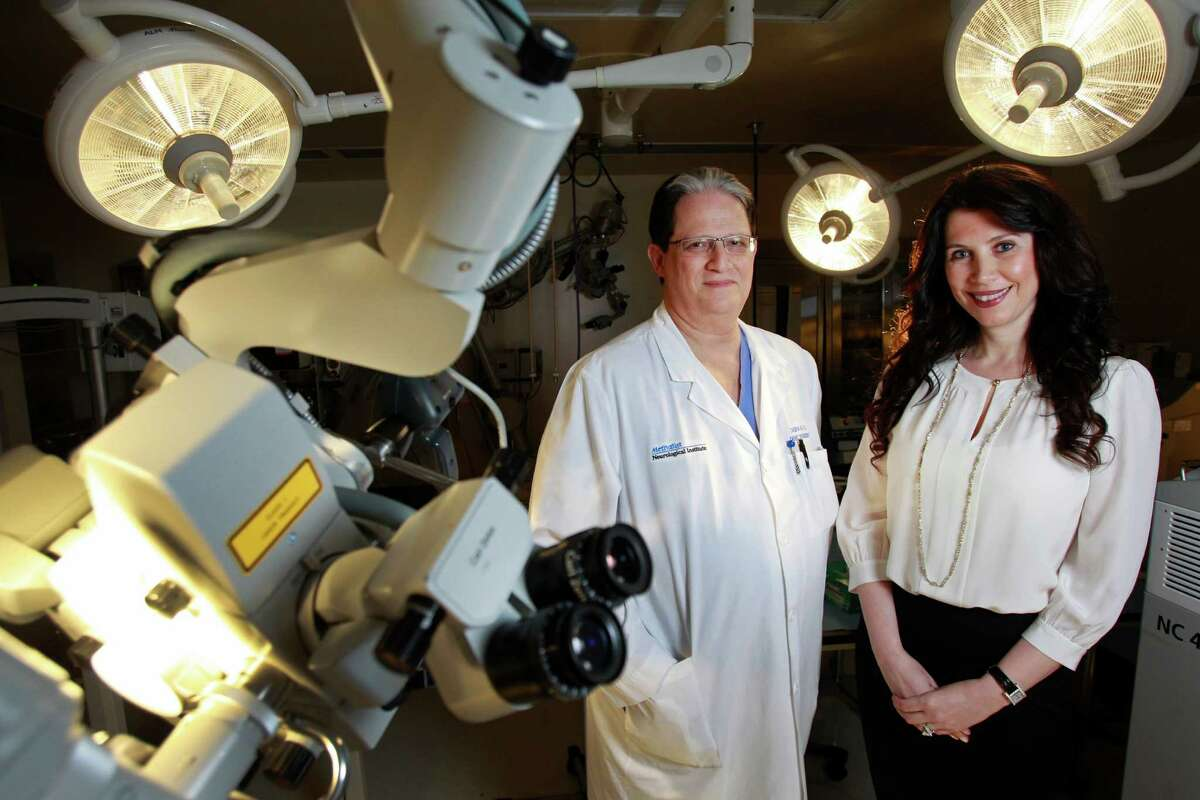 Director Dr. David Baskin and Donna Peak, a biochemist and the wife of the late Kenneth Peak, are surrounded by research equipment at Houston Methodist's Kenneth R. Peak Center for Brain and Pituitary Tumor Treatment and Research. The late Houstonian's family donated $10 million to help fund stem-cell research.
