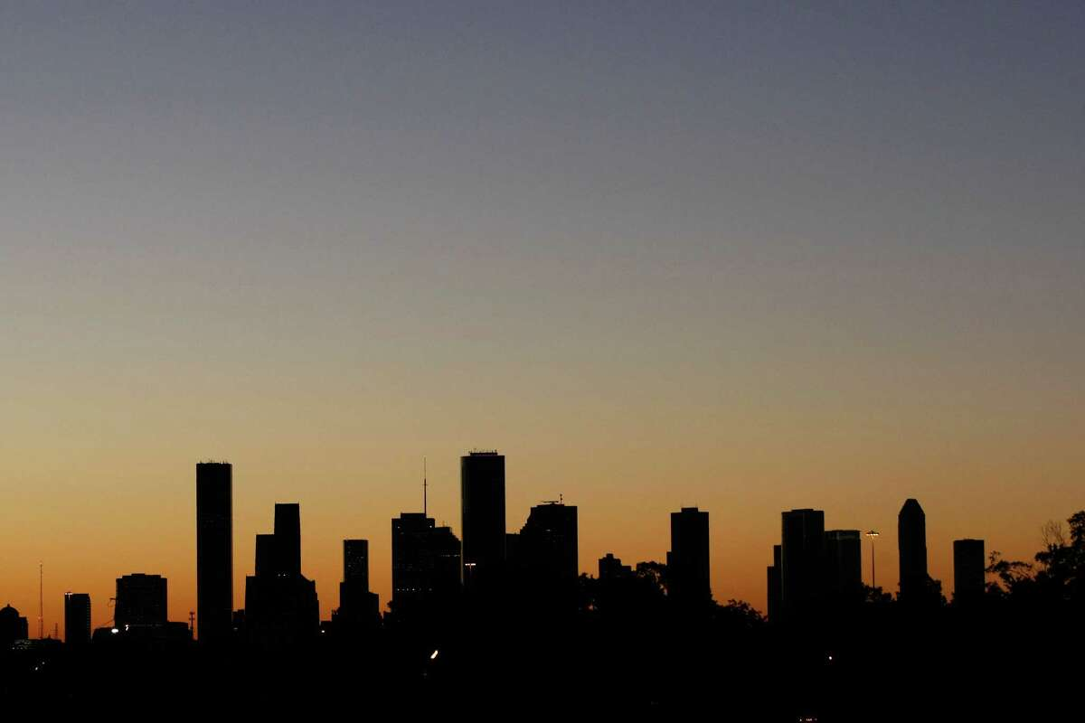 The Houston skyline early as seen from the 580 block of T.C. Jester Boulevard Monday, Oct. 7, 2013, in Houston. ( Johnny Hanson / Houston Chronicle )