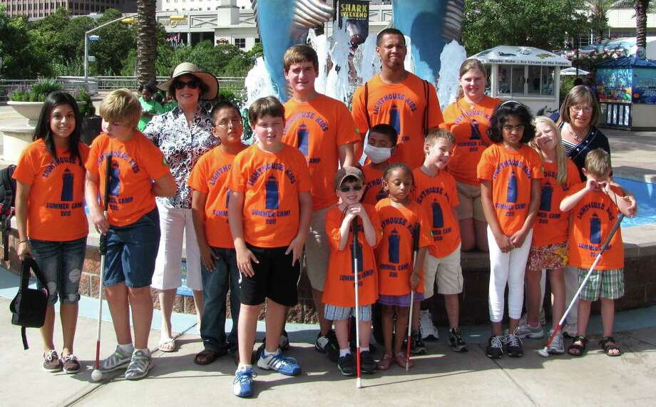 Houston Delta Gamma Foundation member Linda Dussair helped chaperon a group of students from the Lighthouse for the Blind on a trip to the Downtown Aquarium in Houston in 2007. Photo: Karen King