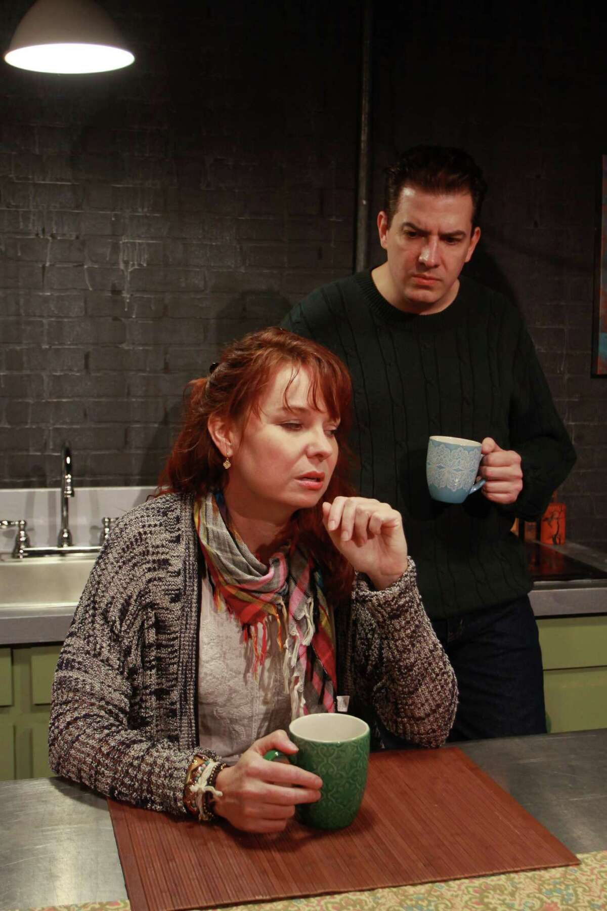 """Sarah (Sara Gaston) and James (Sean Patrick Judge) discover that they have differing views about covering war as journalists in Main Street Theater's Houston premiere of Donald Margulies' play """"Time Stands Still."""""""