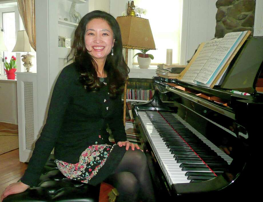 Greenwich resident and concert pianist Sue Song has plenty of grown up fans but she has also discovered that she has a special bond with children. Photo: Anne Semmes / Greenwich Time