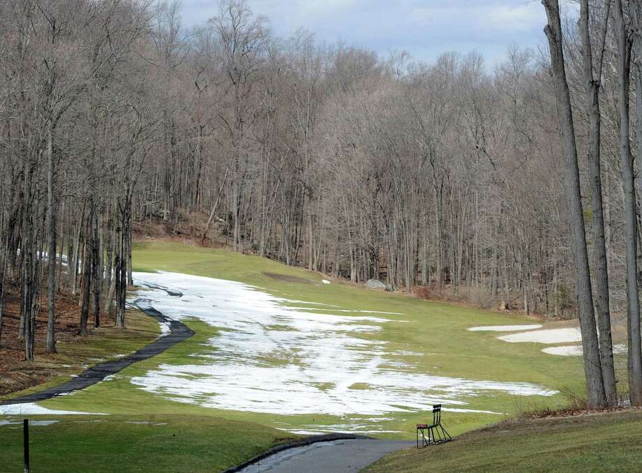 Patches of snow are visible on the 13th fairway at the town-owned Griffith E. Harris Golf Course in Greenwich, Thursday, March 20, 2014. Photo: Bob Luckey / Greenwich Time