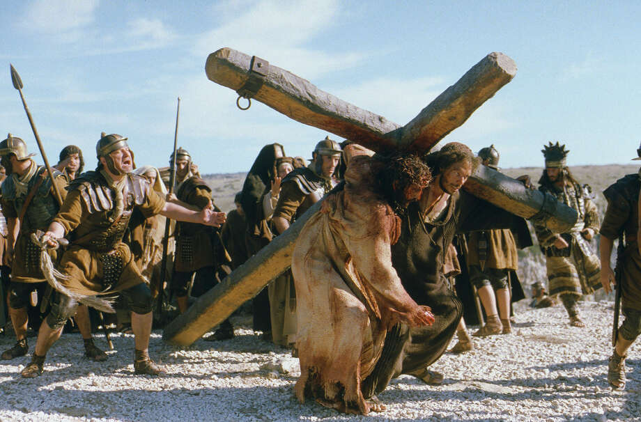 """Passion of the Christ"" (2004)Total earnings: $611,899,420Starring: Jim Caviezel, Monica Bellucci, Maia MorgensternPlot: This movie essentially tells the Easter story, though we're not talking about chocolate candy and fuzzy bunnies. No, this movie shows the Biblical version, complete with Jesus' heartbreaking betrayal and gruesome crucifixion.  Photo: PHILIPPE ANTONELLO, HO / MARQUIS FILM"