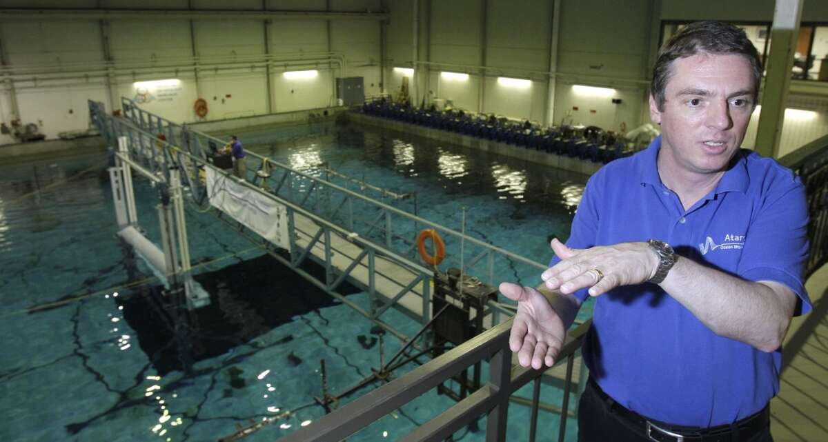Stefan Siegel, president and chief technology officer of Atargis Energy Corporation, talks about the 1:10 scale model of a cycloidal wave energy converter that the company is testing in the wave basin at Texas A&M Offshore Technology Research Center in College Station. Hydrofoil blades on the underwater device rotate to extract energy from waves.