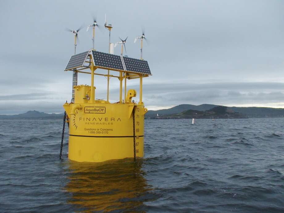 In this undated photo provided by Finavera Renewables, a wave energy converter called an AquaBuOY is shown.  Finavera's 35-ton buoys rise above the water about 6 feet but extend beneath the surface some 60 feet, where a piston encased in an underwater steel cylinder rises and falls with the waves and pushes pressurized seawater through rubber hoses. The water is then pumped into a turbine inside the buoy which spins to create power. Finavera's first ocean test last year ended in disaster when its $2 million buoy deployed off Oregon's coast sunk to the sea floor. Photo: Anonymous, AP