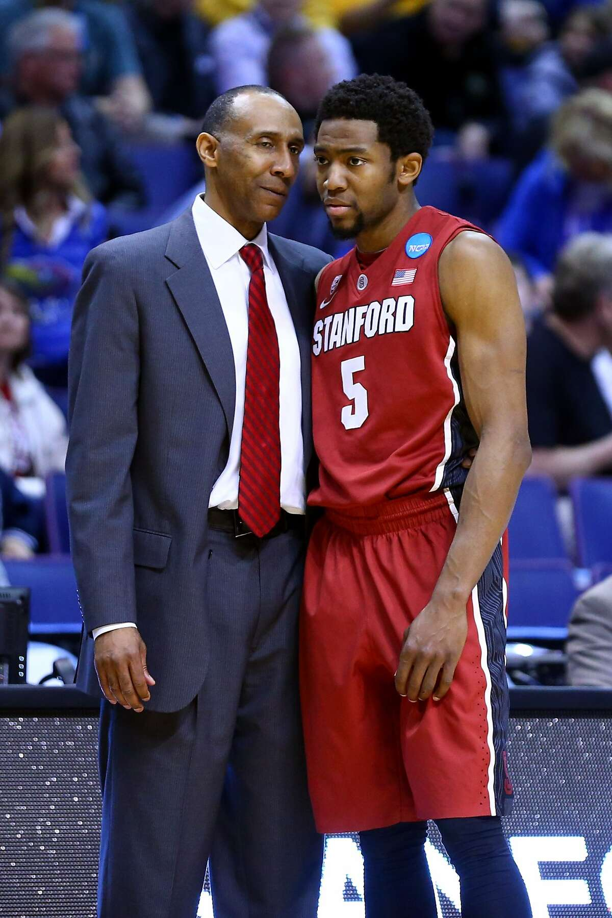 ST LOUIS, MO - MARCH 21: Head coach Johnny Dawkins of the Stanford Cardinal talks with Chasson Randle #5 after a foul by New Mexico Lobos during the second round of the 2014 NCAA Men's Basketball Tournament at Scottrade Center on March 21, 2014 in St Louis, Missouri. (Photo by Dilip Vishwanat/Getty Images)