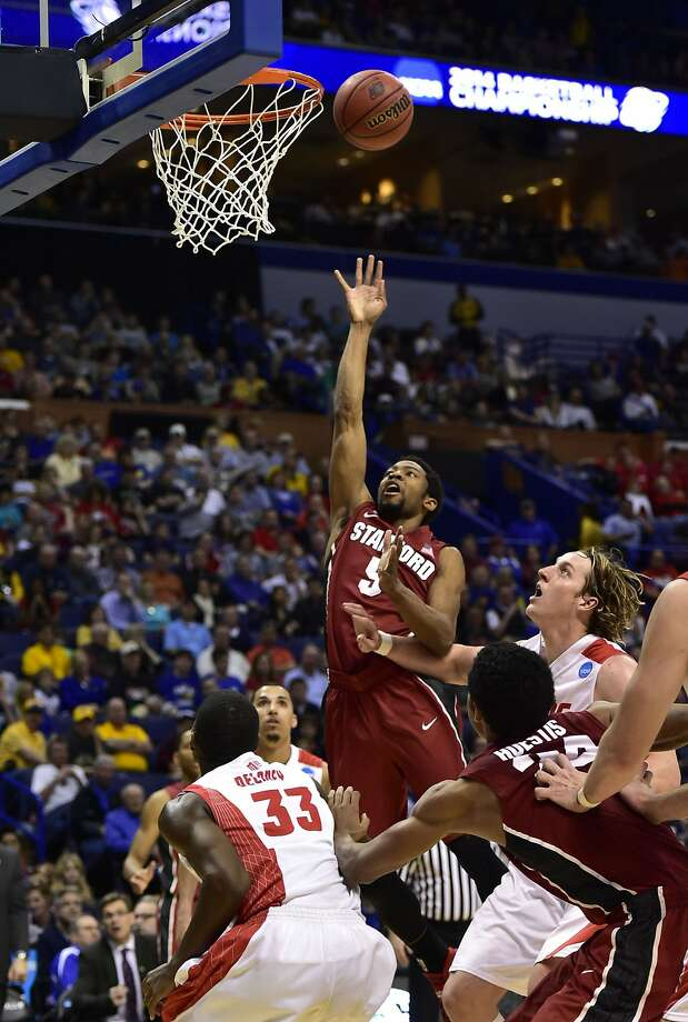 Chasson Randle, who led Stanford with 23 points, puts up a shot over Deshawn Delaney in the second half. Photo: Scott Rovak, Reuters