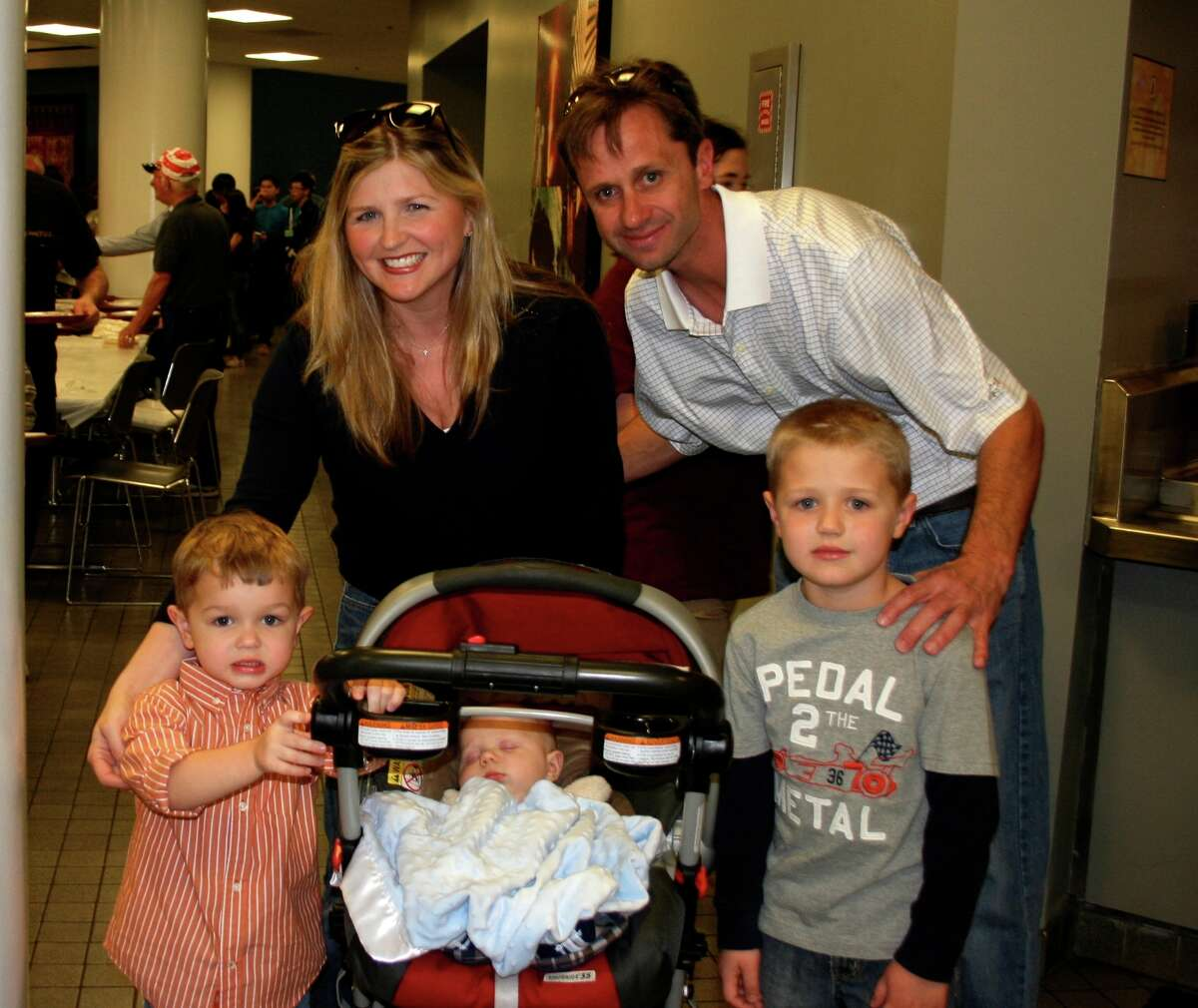 The Spaghetti Dinner always welcomes families. Among those arriving early were Andrew and Brigit Engleman, with their children Gabe, left, Lucky, and baby Cullen.