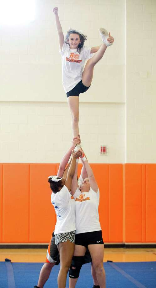 JHessica Torrellas is lifted as Stamford High School cheerleaders practice their routine on Thursday, March 20, 2014. The team will compete this weekend in the New England Regionals in Lawrence, Mass. Photo: Lindsay Perry / Stamford Advocate