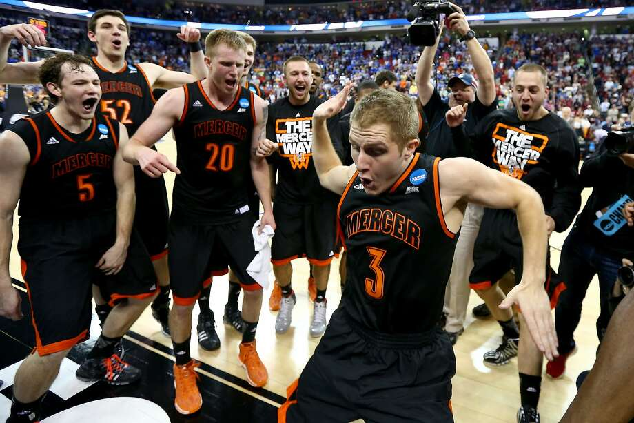 Kevin Canevari (3), a 5-foot-11 backup, is at the center  of the celebration as Mercer's players revel in the Atlantic Sun Conference school's stunning victory over Duke in Raleigh, N.C. Photo: Streeter Lecka, Getty Images