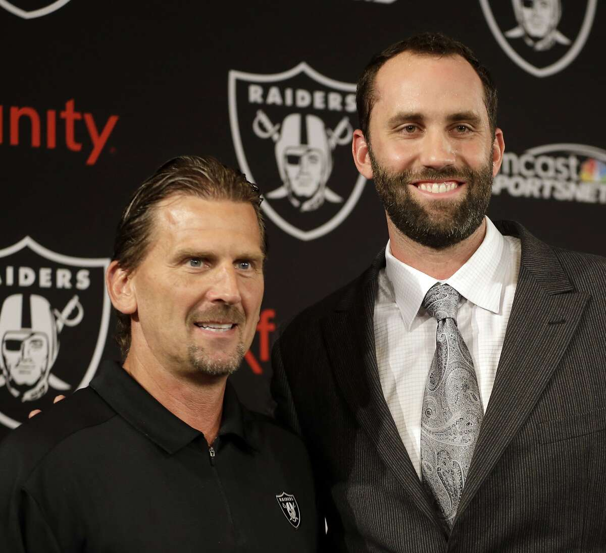 Oakland Raiders quarterback Matt Schaub, right, stands with offensive coordinator Greg Olson after a news conference Friday, March 21, 2014, at the NFL football team's practice facility in Alameda, Calif. Schaub and the Raiders are both hoping to put the mistakes of 2013 in the past. The Raiders acquired Schaub from Houston for an undisclosed draft pick, giving the quarterback a second chance after he lost his starting job with the Texans last season. (AP Photo/Ben Margot)