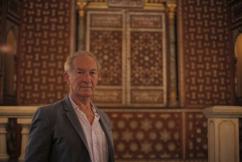 Simon Schama, shown at a Cairo synagogue, tells the story in his own way. Photo: Tim Kirby, PBS