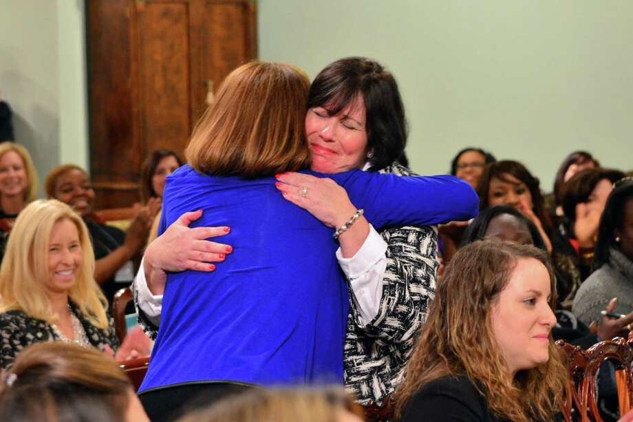 Linda Spevacek and Maureen Wolff of Just Ordinary Moms hugged after it was announced that  they had won oe of four scholarships offered through Ladies Who Launch. Photo: Megan Spicer / Darien News