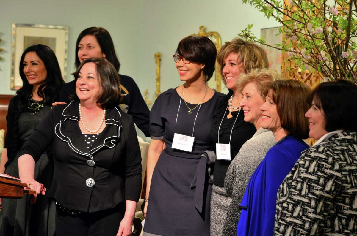 Allyson Spellman, from left, Andrea Greene, Kathy McShane, Katherine Dickson, Teri Gaberman, Linda McMahon, Linda Spevacek and Maureen Wolff stand together after the awards were announced on Thursday, March 20.