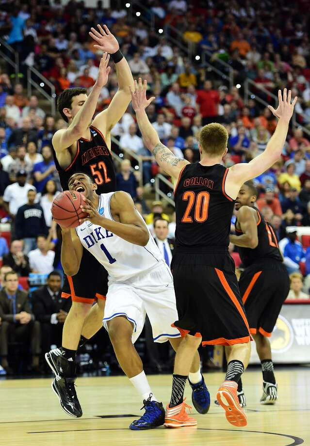 Duke forward Jabari Parker has trouble in traffic against Mercer forwards Daniel Coursey and Jakob Gollon. Photo: Bob Donnan, Reuters