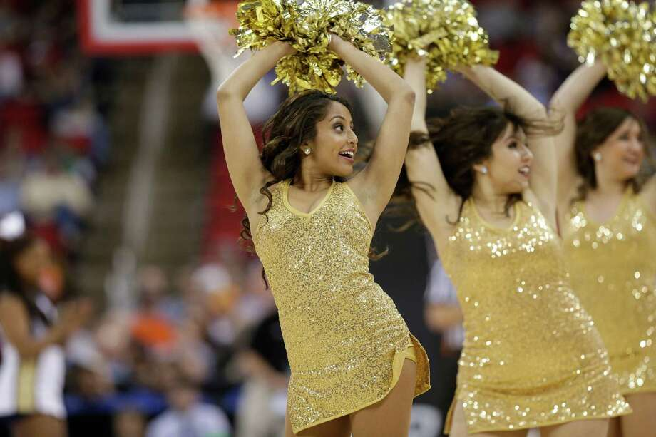 Memphis cheerleaders perform against George Washington during the first half of an NCAA college basketball second-round tournament game, Friday, March 21, 2014, in Raleigh. (AP Photo/Chuck Burton) Photo: Chuck Burton, Associated Press / AP