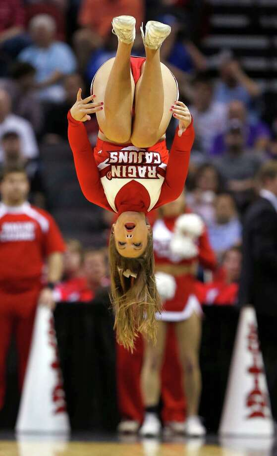 SAN ANTONIO, TX - MARCH 21:  A Louisiana Lafayette Ragin Cajuns cheerleader performs a backflip in the second half against the Creighton Bluejays during the second round of the 2014 NCAA Men's Basketball Tournament at AT&T Center on March 21, 2014 in San Antonio, Texas. Photo: Tom Pennington, Getty Images / 2014 Getty Images