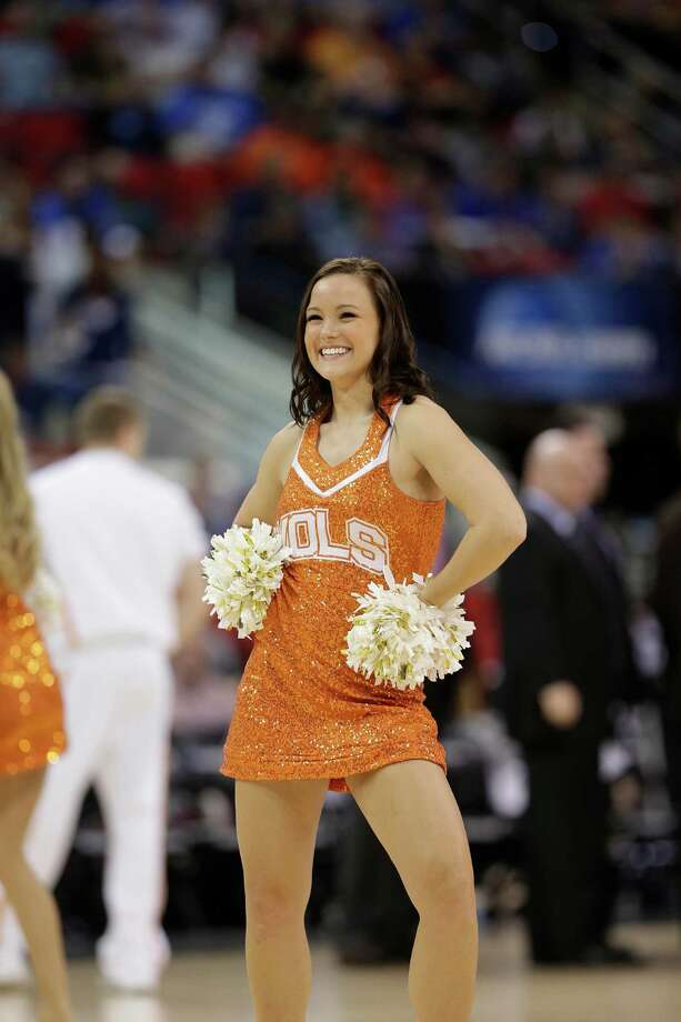 Tennessee cheerleaders perform against Massachusetts during the first half of an NCAA college basketball second-round tournament game, Friday, March 21, 2014, in Raleigh, N.C.  (AP Photo/Chuck Burton) Photo: Chuck Burton, Associated Press / AP