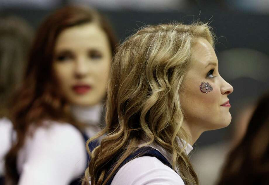 A Gonzaga cheerleader wears a bulldog decal during the first half in a second-round game in the NCAA college basketball tournament Friday, March 21, 2014, in San Diego. (AP Photo/Gregory Bull) Photo: Gregory Bull, Associated Press / AP