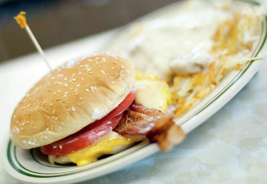 FILE - In this Wednesday, June 26, 2013, file photo, a breakfast sandwich is photographed at the Triple XXX restaurant in West Lafayette, Ind. Breakfast is now being served with a dose of sticker shock. The cost of morning staples like bacon, coffee and orange juice is surging on a host of global supply problems, from drought in Brazil to disease on U.S. pig farms.  (AP Photo/Journal & Courier, Brent Drinkut) ORG XMIT: INLAF201 Photo: Brent Drinkut / The Journal & Courier