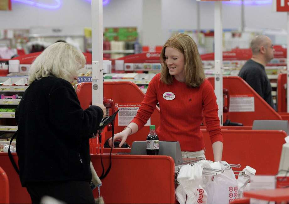 FILE - In this  Friday, Nov. 18, 2005, file photoCashier Nora Poage rings up a purchase at a Target store in Seattle Wash.  A federal appeals court has handed a defeat to a coalition of retail groups that challenged as too high the Federal Reserve's cap on how much banks can charge businesses for handling debit card transactions. The ruling issued Friday, March 21, 2014 by the U.S. Appeals Court for the District of Columbia overturned a lower court's decision in July that favored the merchants and was a setback for banks. (AP Photo/Ted S. Warren, File) ORG XMIT: NYBZ165 Photo: TED S. WARREN / AP