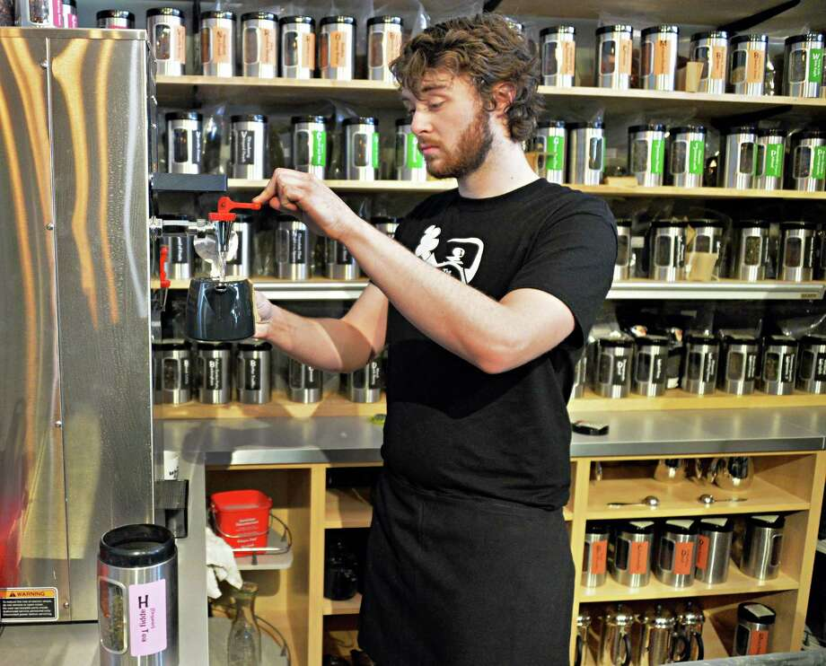 Adam Benoit prepares a customer's tea at the Whistling Kettle's new Troy location at 254 Broadway Friday March 21, 2014, in Troy, N.Y.  (John Carl D'Annibale / Times Union) Photo: John Carl D'Annibale / 00026234A