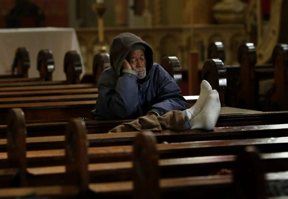 Norval Hendricks Sr. rested in the pews of St. Boniface Monday March 17, 2014. The Gubbio project at St. Boniface Catholic church in San Francisco, Calif is celebrating its ten year anniversary helping homeless find some sleep and peace from street life.