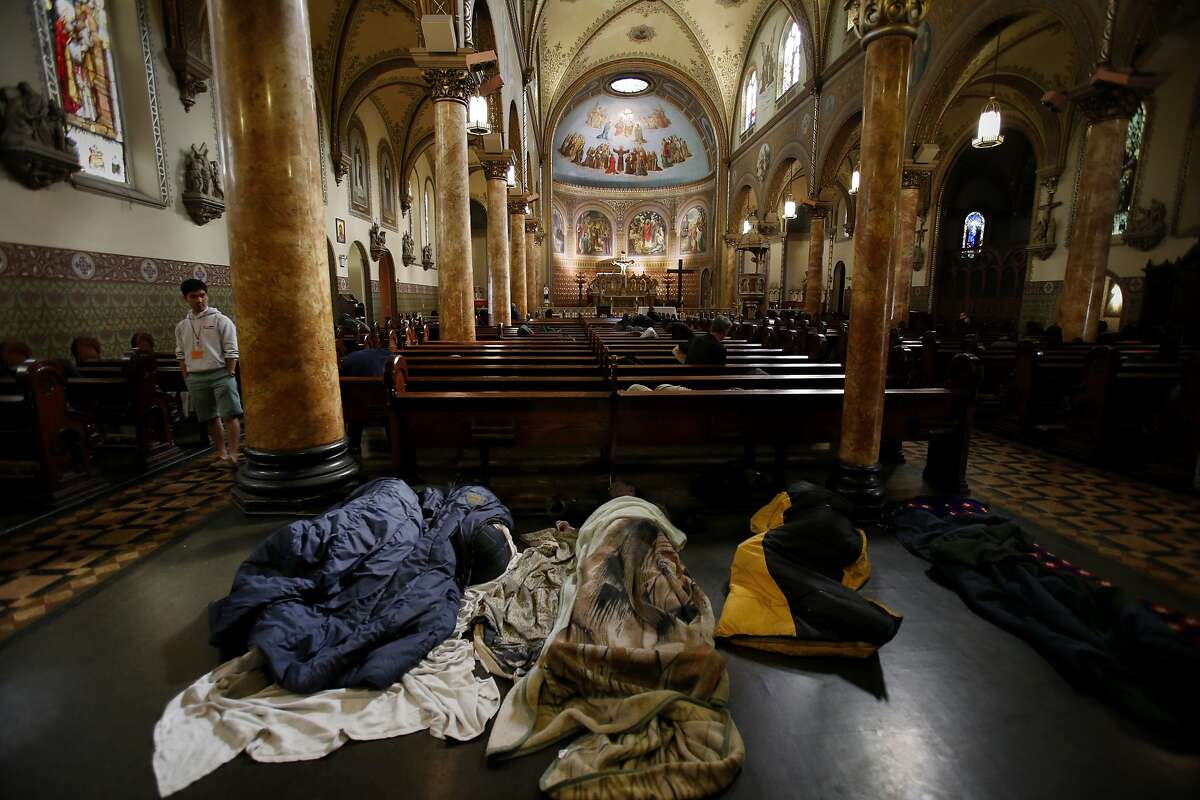 The pews at St. Boniface are so crowded that some end up sleeping on the floor Monday March 17, 2014. The Gubbio project at St. Boniface Catholic church in San Francisco, Calif is celebrating its ten year anniversary helping homeless find some sleep and peace from street life.