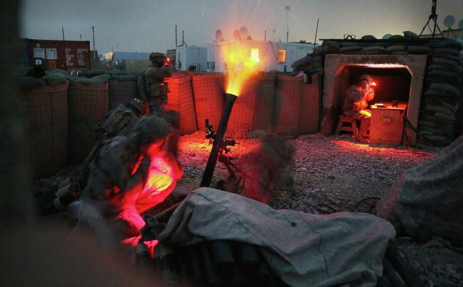 Soldiers with the U.S. Army's 3rd Brigade Combat Team, 10th Mountain Division fire a mortar round during a training exercise on FOB Lightning near Gardez, Afghanistan. The brigade advises and assists the Afghan army. Photo: Scott Olson / Getty Images / 2014 Getty Images
