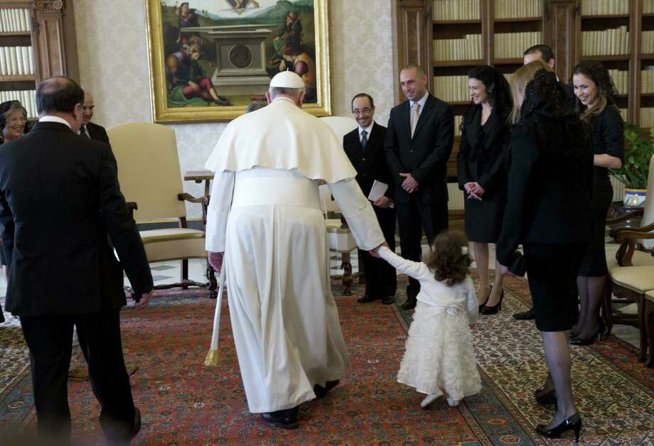 "Pope Francis walks with Giorgia May, the granddaughter of Malta's President George Abela, during a private audience at the Vatican. The pontiff warned Italy's mobsters that they risk going to hell if they don't change their ""blood-stained""ways. Photo: AFP / Getty Images / AFP"