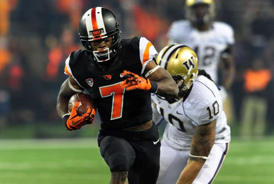 Brandin Cooks | Wide Receiver | Oregon StateCooks, on the other hand, may provide a ready-made replacement for the dynamic Golden Tate. Cooks is a smooth route-runner and possess sure hands, recently drawing favorable comparisons to Denver Broncos star Wes Welker. That's enough for CBSSports' Will Brinson to slot him to Seattle. Photo: Steve Dykes, Getty Images