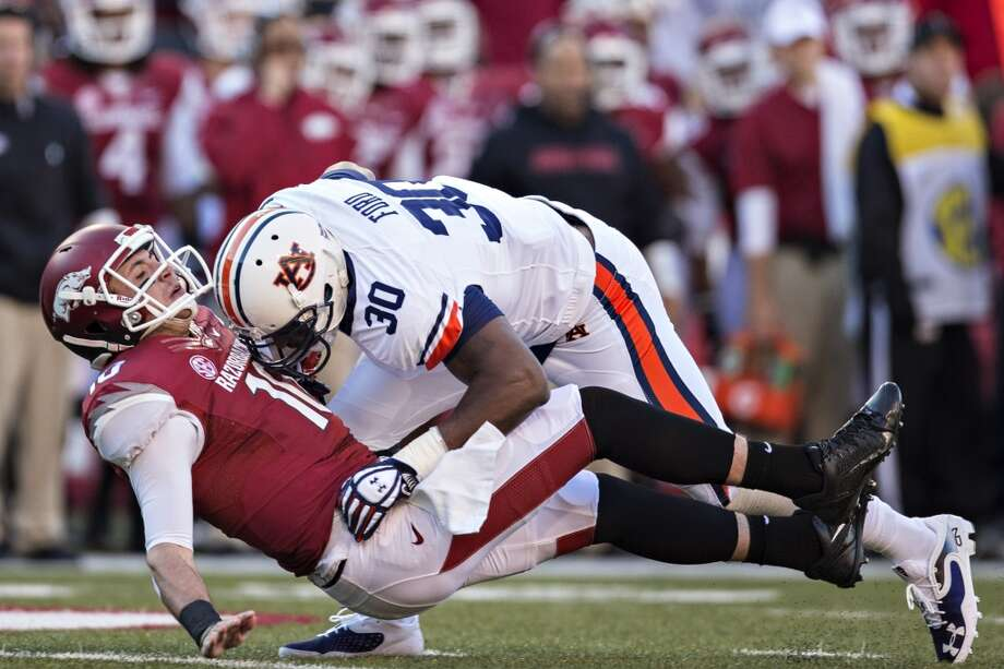 Dee Ford   Defensive end   AuburnFord tested well in Auburn's pro day earlier this month, running a sub-4.6 second 40-yard dash and posting 29 reps of 225 pounds on the bench press. WalterFootball has him coming to the Seahawks, where the explosive pass-rusher could eventually replace Cliff Avril, whose contract is up after next season. Photo: Wesley Hitt, Getty Images
