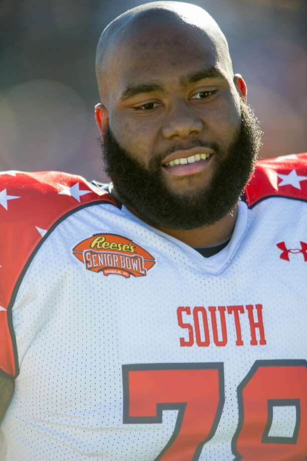 Morgan Moses | Offensive tackle | Virginia  Moses has performed well in the pre-draft process, with a solid Senior Bowl and combine. That, combined with his potential to be a dominant run-blocker at the next level has Bleacher Report's Michael Schottey choosing him for Seattle. Photo: Michael Chang, Getty Images
