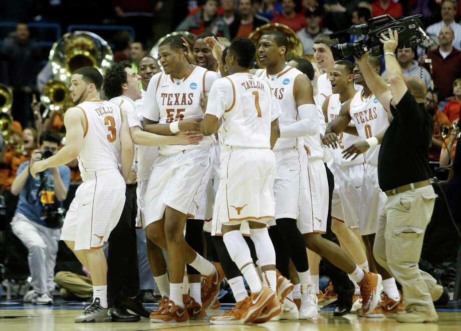 UT's Cameron Ridley (55) was the center of attention after his winning basket Thursday. Photo: Mike McGinnis, Stringer / 2014 Getty Images
