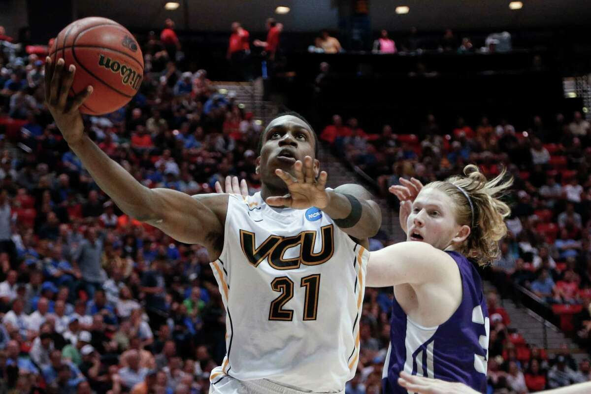 Virginia Commonwealth guard Treveon Graham shoots past Stephen F. Austin forward Jacob Parker during the second half of a second-round game in the NCAA college basketball tournament Friday, March 21, 2014, in San Diego. (AP Photo/Lenny Ignelzi)
