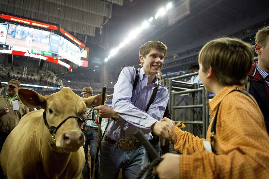 Kaden Hatla, 17, is congratulated by another competitor after Hatla being chosen as the Reserve Grand Champion Steer of Show at the Houston Livestock Show and Rodeo, Friday, March 21, 2014, in Houston. Photo: Marie D. De Jesus, Houston Chronicle / © 2014 Houston Chronicle