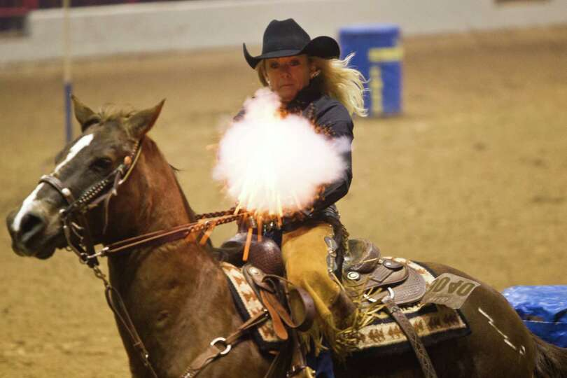 Glenda Wilson competes on the cowboy mounted shooting at the Houston Livestock Show and Rodeo, Frida