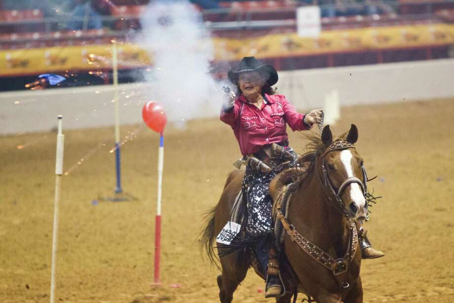 Collette Neuman competes on the cowboy mounted shooting at the Houston Livestock Show and Rodeo, Friday, March 21, 2014, in Houston. Photo: Marie D. De Jesus, Houston Chronicle / © 2014 Houston Chronicle