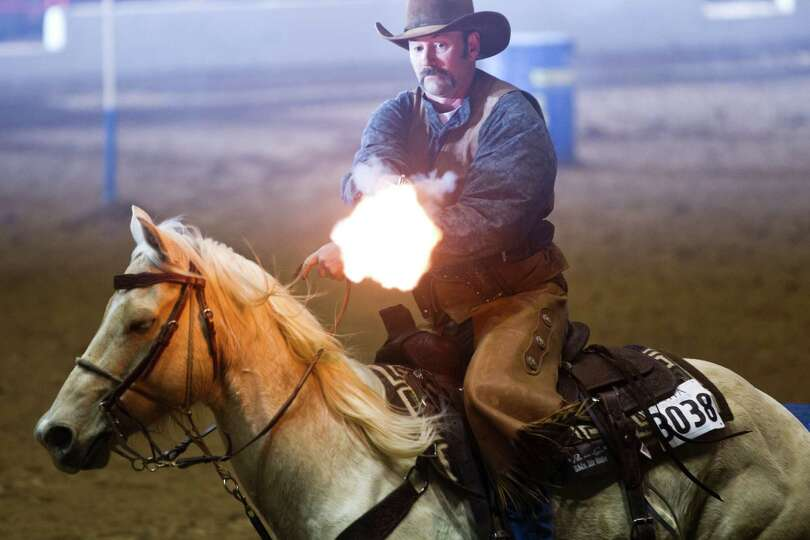 Byron Walters competes on the cowboy mounted shooting at the Houston Livestock Show and Rodeo, Frida