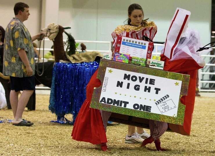 Tiffany Anderson, 17, dresses her alpaca, Rocky Chocolate, as movie concessions during the costume c